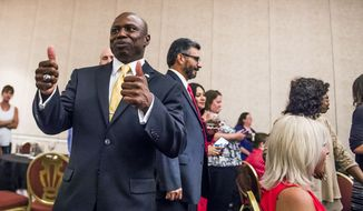 El Paso County Commissioner Darryl Glenn gives two thumbs during the U.S. Senate Republican Primary, Tuesday, June 28, 2016  in Colorado Springs, Colo. Glenn has won Colorado's Republican U.S. Senate primary and will face incumbent Democrat Michael Bennet in November.  (Stacie Scott/The Gazette via AP)