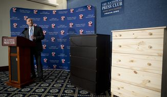 With two Ikea dressers displayed at right, Consumer Product Safety Commission (CPSC) Chairman Elliot Kaye speaks during a news conference at the National Press Club in Washington, Tuesday, June 28, 2016. Ikea is recalling 29 million chests and dressers after six children were killed when the furniture toppled over and fell on them. (AP Photo/Carolyn Kaster)