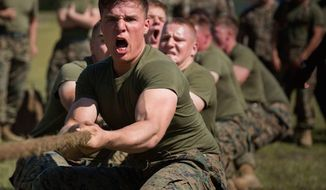 Marines engage in a Tug of War contest at Ellis Field on Camp Lejeune, North Carloina, March 17, 2016. (Facebook, U.S. Marine Corps, Lance Cpl. Tyler W. Stewart/Released)