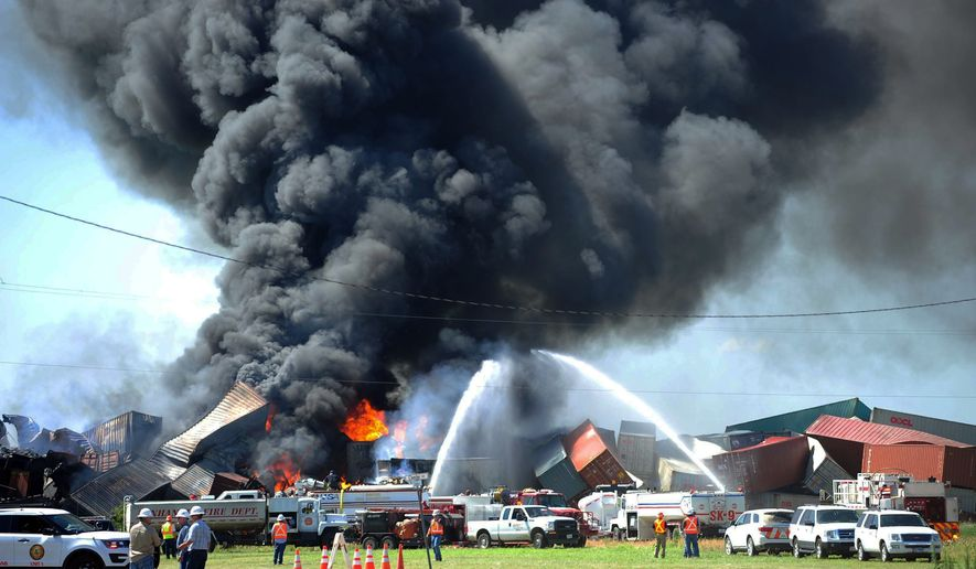 Three crew members were missing and one was hurt Tuesday, June 28, 2016, after a head-on train collision in Panhandle, Texas, that caused several box cars to erupt in flames and led authorities to evacuate residents in the area. (Sean Steffen/Amarillo Globe-News via AP) ** FILE **