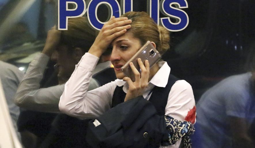 A woman reacts outside Istanbul's Ataturk airport on Tuesday after suspected Islamic State group extremists attacked the international terminal of Istanbul's Ataturk airport. (Associated Press)