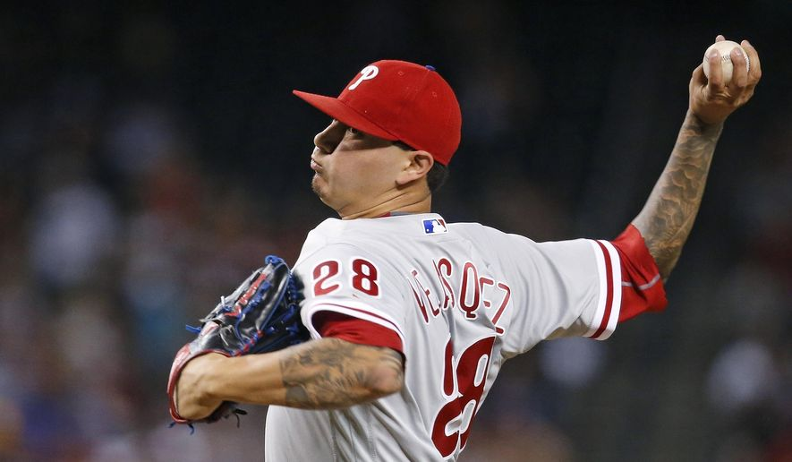 Philadelphia Phillies' Vince Velasquez throws a pitch against the Arizona Diamondbacks during the first inning of a baseball game Monday, June 27, 2016, in Phoenix. (AP Photo/Ross D. Franklin)