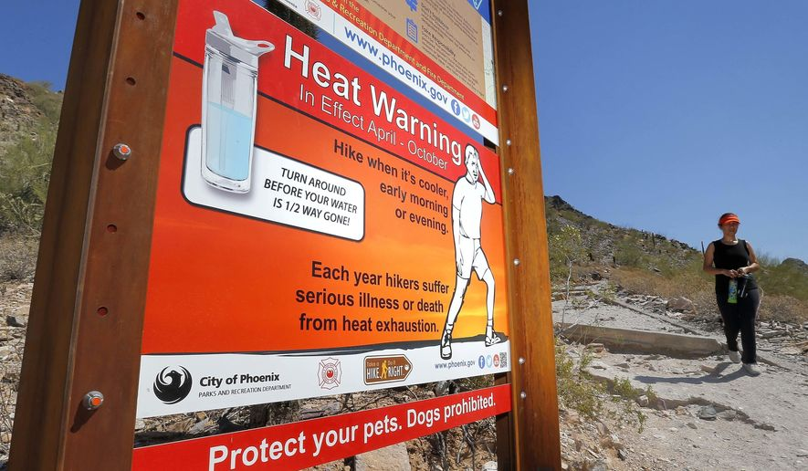 FILE - In this June 22, 2016 file photo, a sign warning of extreme heat is seen on a trailhead at Piestewa Peak in Phoenix. Thirty-one of the country's top science organizations are telling Congress that global warming is real, a problem and something needs to be done about it. The science groups, which represent millions of scientists, sent the letter Tuesday, June 28, 2016, saying the severity of climate change is increasing and will get worse faster in coming decades.  (AP Photo/Matt York, File)