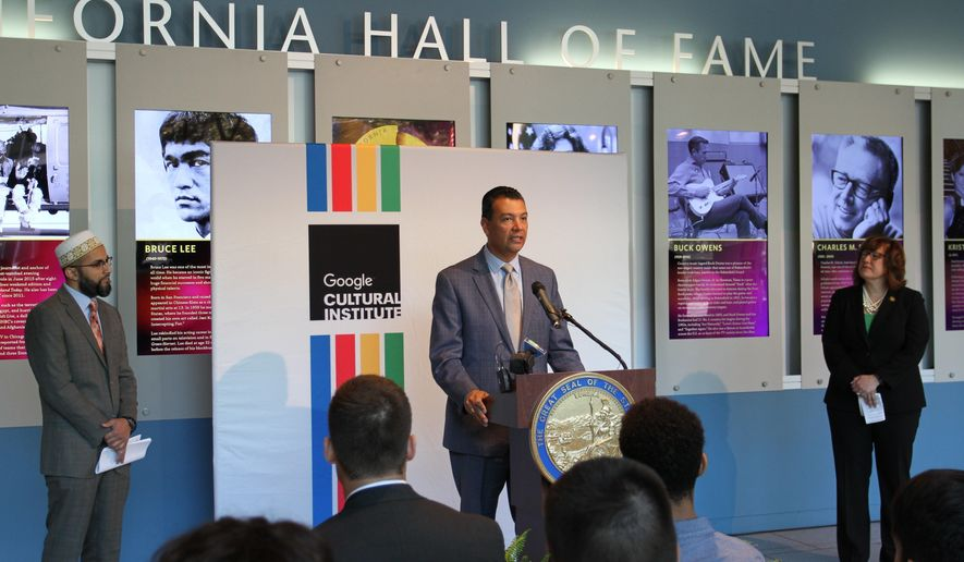 California Secretary of State Alex Padilla, center, announces a partnership between the California State Archives and the Google Cultural Institute at a press conference, Tuesday, June 28, 2016, in Sacramento, Calif. Together, the two will make digitized artifacts and documents from California's history available online. (AP Photo/Darcy Costello)