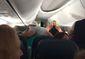tebow delta flight.jpg