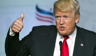 Republican presidential candidate Donald Trump gives a thumbs-up while addressing the Faith and Freedom Coalition's Road to Majority Conference in Washington on June 10, 2016. (Associated Press) **FILE**