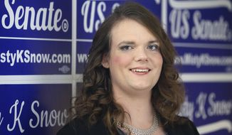 Democratic candidate for Senate Misty Snow poses for a photograph Tuesday, June 28, 2016, in Salt Lake City. Snow won Utah's Democratic U.S. Senate primary. The transgender woman making her first foray into politics will face off against incumbent Republican Sen. Mike Lee in November after winning the Democratic nomination. (AP Photo/Rick Bowmer)