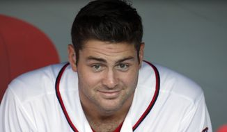 Washington Nationals starting pitcher Lucas Giolito (44) sits in the dugout before a baseball game against the New York Mets at Nationals Park, Wednesday, June 29, 2016, in Washington. (AP Photo/Alex Brandon)