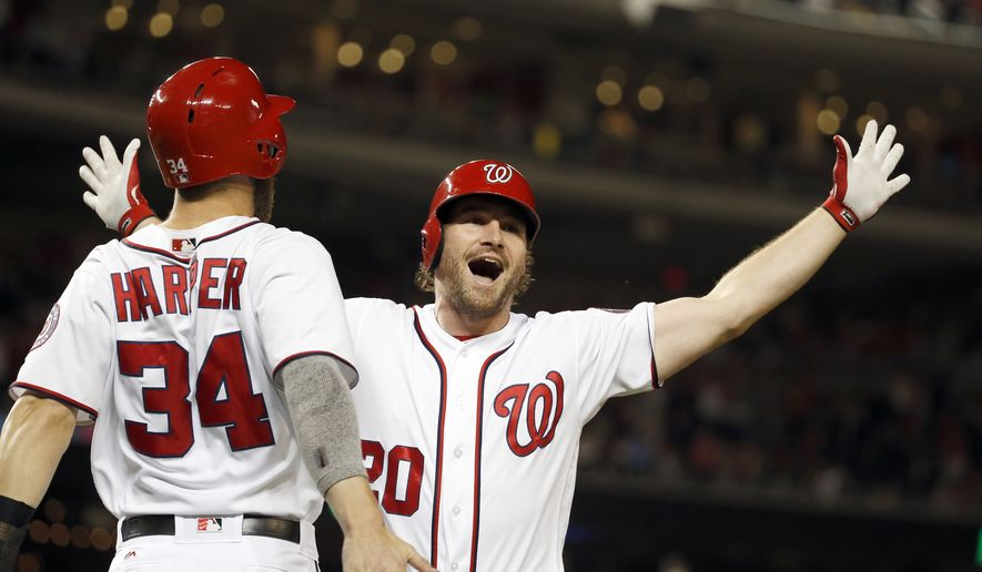 Washington Nationals' Bryce Harper (34) celebrates with Daniel Murphy (20) after Murphy's two-run homer during the eighth inning of a baseball game against the New York Mets at Nationals Park, Wednesday, June 29, 2016, in Washington. The Nationals won 4-2.(AP Photo/Alex Brandon)