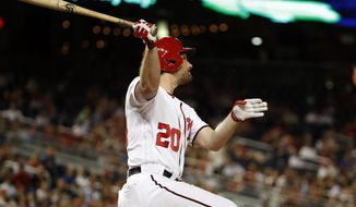 Washington Nationals' Daniel Murphy watches his two-run home run during the eighth inning of a baseball game against the New York Mets at Nationals Park, Wednesday, June 29, 2016, in Washington. The Nationals won 4-2. (AP Photo/Alex Brandon)