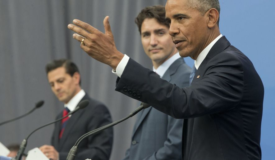 President Barack Obama, accompanied by Canadian Prime Minister Justin Trudeau and Mexican President Enrique Pena Neito, speaks during their trilateral news conference for the North America Leaders' Summit at the National Gallery of Canada, Wednesday, June 29, 2016 in Ottawa, Canada. (AP Photo/Pablo Martinez Monsivais)