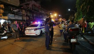 In this June 8, 2016 file photo, police conduct an overnight curfew for minors in Manila, Philippines. (AP Photo/Aaron Favila)