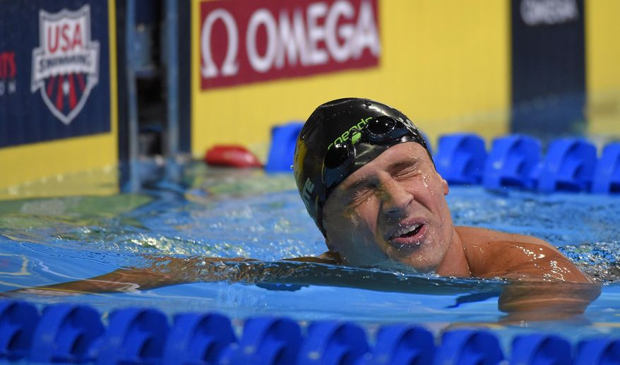 Ryan Lochte reacts after swimming in the men's 200-meter freestyle final at the U.S. Olympic swimming trials, Tuesday, June 28, 2016, in Omaha, Neb. (AP Photo/Mark J. Terrill)