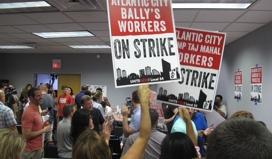 Union members cheer as they discuss preparations for a strike against as many as five of the city's eight casinos in Atlantic City, N.J. on Wednesday June 29, 2016.  Local 54 of the Unite-HERE union says it will go on strike Friday if it can't reach new contracts with three casinos owned by Caesars Entertainment (Bally's, Caesars and Harrah's) and two casinos owned by billionaire investor Carl Icahn (the Tropicana and the Trump Taj Mahal). About 6,500 of the union's nearly 10,000 workers are at the five hotels.  (AP Photo/Wayne Parry)