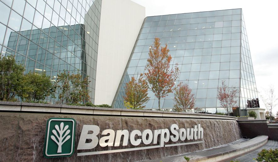 This photo taken Oct. 31, 2006, shows the exterior of the BancorpSouth headquarters in Tupelo, Miss. The Department of Justice and the Consumer Financial Protection Bureau fined Mississippi-based BancorpSouth $10.6 million, Wednesday, June 29, 2016, alleging the bank deliberately discriminated against minorities in its lending practices. (Thomas Wells/The Northeast Mississippi Daily Journal, via AP)