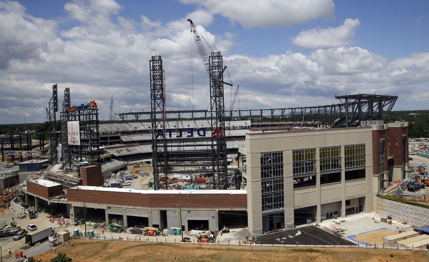 FILE- In this May 5, 2016, file photo, work continues on SunTrust Park, the future home of the Atlanta Braves baseball team in Atlanta. The Braves are scheduled to open SunTrust Park in April 2017, according to a copy of the team's preliminary schedule obtained by The Associated Press. (AP Photo/John Bazemore, File)