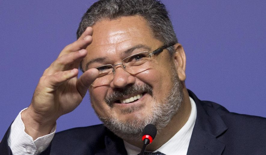 Brazil's Olympic soccer coach Rogerio Micale gestures during a press conference in Rio de Janeiro, Brazil, Wednesday, June 29, 2016. Micale named Brazil's Olympic soccer team, which includes two key players who did not play in the Copa America : Barcelona's Neymar and Douglas Costa of Bayern Munich. Micale took over the soccer team when Dunga was fired after Brazil was knocked out of the Copa America. (AP Photo/Silvia Izquierdo)