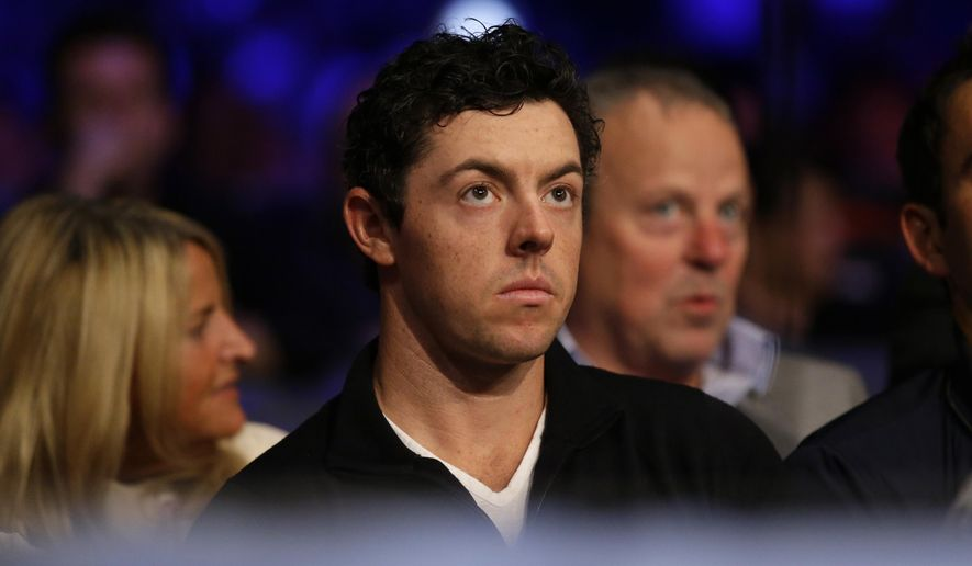 British golfer Rory McIlroy sits ringside several fights before Anthony Joshua fights U.S. boxer Dominic Breazeale in an IBF heavyweight title bout at the O2 Arena in London, Saturday, June 25, 2016. (AP Photo/Matt Dunham)