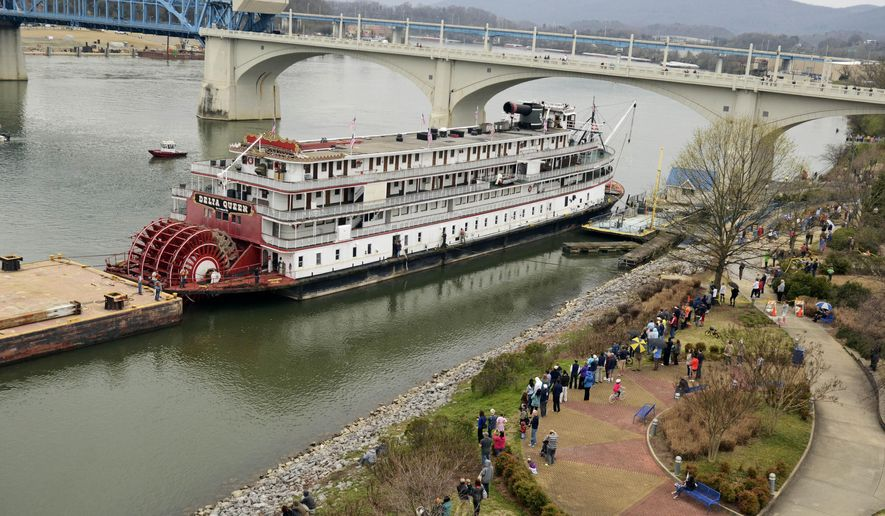 FILE - In this March 22, 2015 file photo, spectators line the bank of the Tennessee River as the Delta Queen riverboat waits to depart from Chattanooga, Tenn., on its way to Louisiana for restoration. An effort to get the legendary riverboat back afloat on the Mississippi River and its tributaries got a boost after the U.S. Senate Commerce Committee on Wednesday, June 29, 2016, agreed to reinstate an exemption for the vessel. The measure now goes to the full Senate. (John Rawlston/Chattanooga Times Free Press via AP, File) THE DAILY CITIZEN OUT; NOOGA.COM OUT; CLEVELAND DAILY BANNER OUT; LOCAL INTERNET OUT; MANDATORY CREDIT