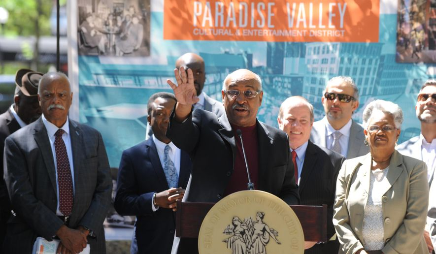 Charlie Beckham announces five Detroit-based firms that will redevelop the Paradise Valley Cultural and Entertainment District surrounding Beatrice Buck Park, formerly known as Harmonie Park, Wednesday June 29, 2016 in Detroit, Michigan. (Max Ortiz/Detroit News via AP)  DETROIT FREE PRESS OUT; HUFFINGTON POST OUT; MANDATORY CREDIT