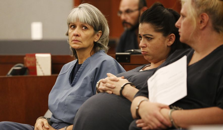Jerry Nann Meador, left, appears in court Wednesday, June 29, 2016, in Las Vegas. Attorneys are trying to get a judge to invoke a little-used state law allowing for a court diversion program instead of prison for Meador, who claims a gambling addiction made her siphon more than $500,000 from the business where she worked. (AP Photo/John Locher)