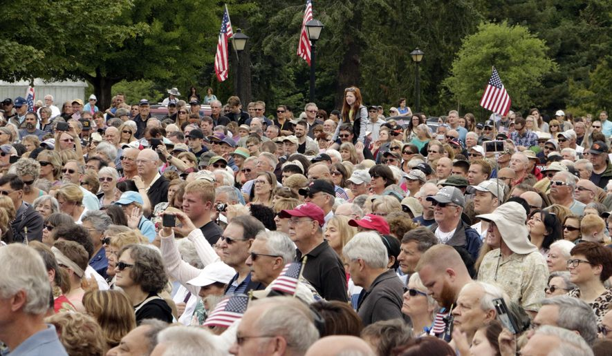 Thousands of people listen to evangelist Franklin Graham outside the Capitol in Olympia, Wash., on Wednesday, June 29, 2016. Graham's visit was part of a national tour to urge Christians to get involved in politics. (AP Photo/Rachel La Corte)