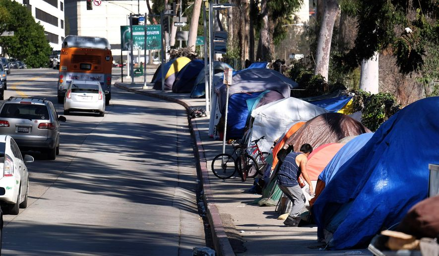 FILE - In this Jan. 26, 2016, file photo, tents from a homeless encampment line a street in downtown Los Angeles. The Los Angeles City Council will ask voters to pass a $1.2 billion bond measure to fight homelessness. The council voted Wednesday, June 29, 2016, to place a measure on the November ballot to raise a decade's worth of funding to provide housing and services for the homeless and those in danger of becoming homeless. (AP Photo/Richard Vogel, File)