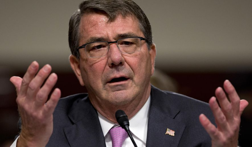 Defense Secretary Ashton Carter testifies on Capitol Hill in Washington in this July 7, 2015, file photo. The expected launch of new rules allowing transgender individuals to serve openly in the U.S. military is drawing concerns from senior military leaders who believe the Pentagon is moving too fast and has yet to resolve many details and questions. The Pentagon plans to unveil the new regulations in the next day or two. (AP Photo/Carolyn Kaster, File)