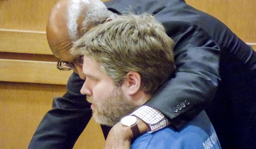 Matthew Skalitzky, seated , talks to his lawyer, Stanley Woodard, before a hearing, Wednesday June 29, 2016, in Dane County Court in Madison, Wis. Skalitzky, who who killed his mother with a sword last year, pleaded guilty Wednesday to first-degree intentional homicide, then was committed to a state mental hospital after prosecutors and defense lawyers in the case agreed that he was mentally ill at the time of the killing.   (Ed Trevelen/Wisconsin State Journal via AP)