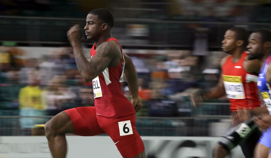 FILE - In this March 18, 2016, file photo, United States' Trayvon Bromell, left, pulls away from competitors to place first in a heat of the men's 60-meter sprint during the World Indoor Athletics Championships in Portland, Ore. Bromell nearly gave up track after breaking his right knee while executing a backflip in eighth grade. And again when he broke the left one in ninth grade playing basketball. And a third time in 10th grade, when he fractured his hip while running the 100 meters. But the 20-year-old stuck with it and may be the biggest challenger in the way of Usain Bolt and at the Rio de Janeiro Olympics. (AP Photo/Elaine Thompson, FIle)