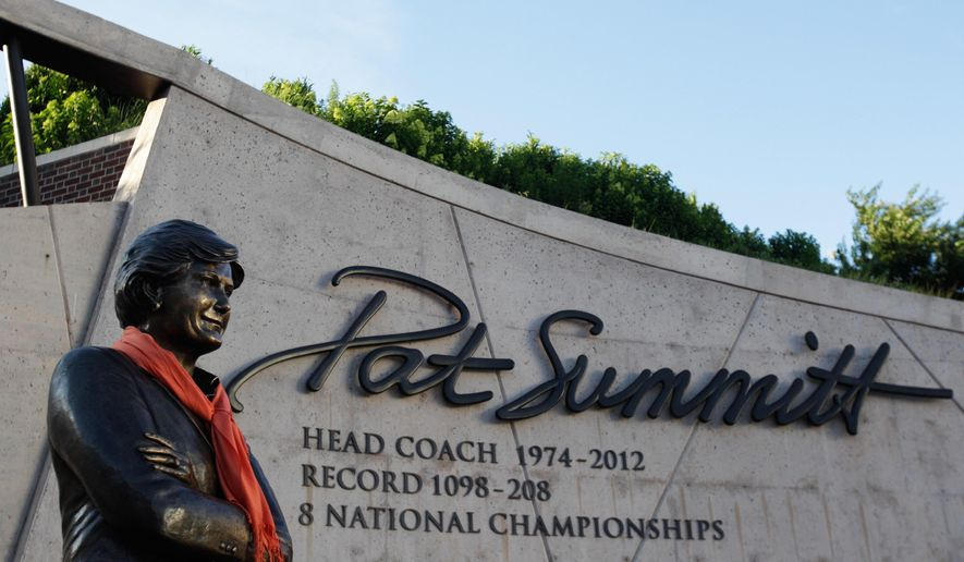 An orange scarf is placed around the statue of Pat Summitt before a candlelight vigil at the Pat Summitt Plaza, Wednesday, June 29, 2016, in Knoxville, Tenn. Summitt, the winningest coach in Division I college basketball history who uplifted the women's game from obscurity to national prominence during her career at Tennessee, died Tuesday. She was 64. (AP Photo/Wade Payne)