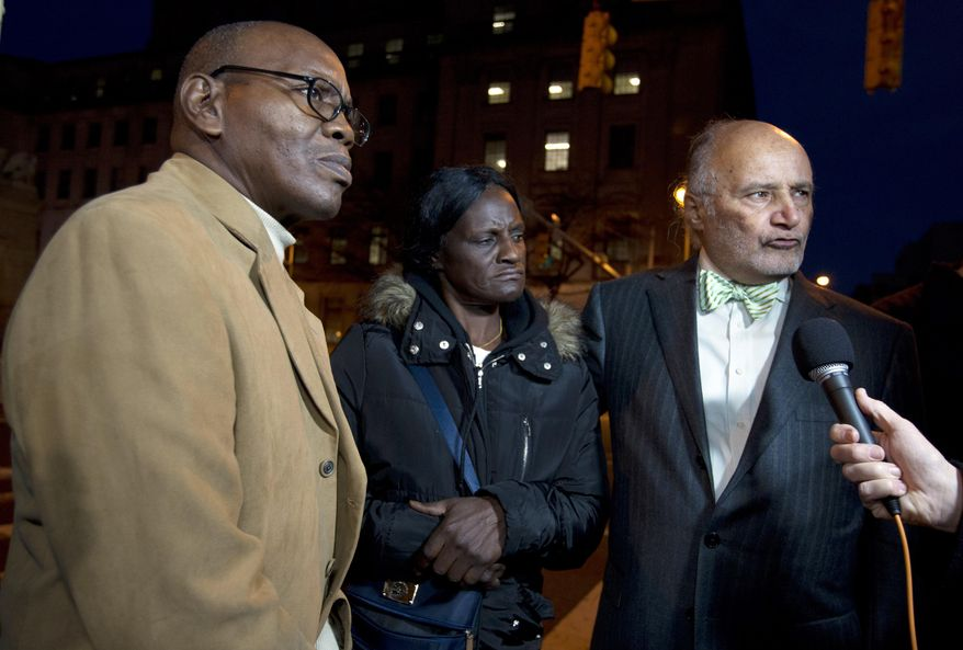 In this Dec. 16, 2015, file photo, Richard Shipley, Freddie Gray' stepfather, left, with Gray's mother Gloria Darden and lawyer Billy Murphy speaks with the media in Baltimore Md. An Associated Press review of court records nationwide shows that the attorneys who represent cities are sometimes weak links in the systems meant to hold police accountable for wrongdoing. The review found that lawyers deliberately hid important facts, delayed their disclosure or otherwise sought to subvert evidence in civil cases. Gray's family sued after he was fatally injured in police custody. (AP Photo/Jose Luis Magana)