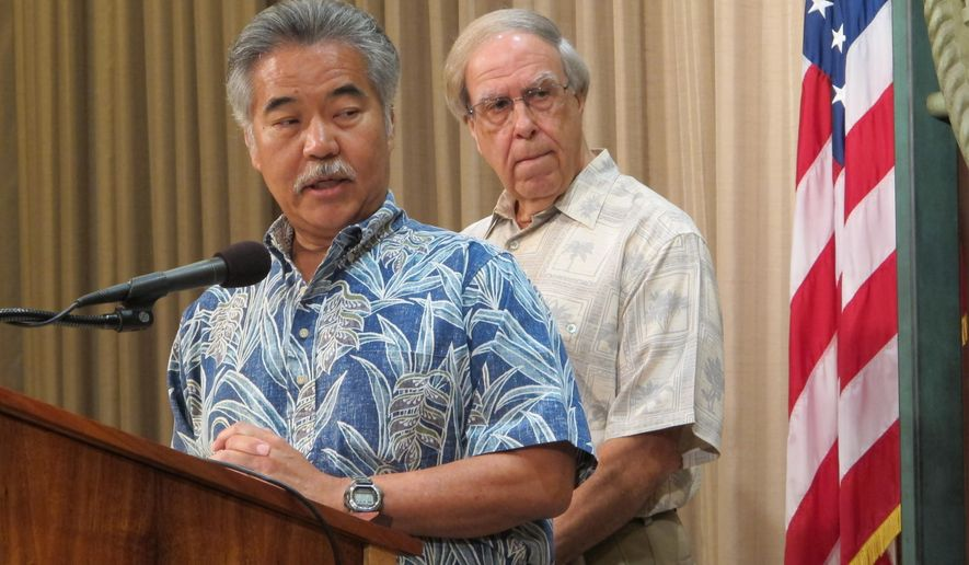 Hawaii Gov. David Ige, left, speaks at a news conference in Honolulu on Wednesday, June 29, 2016 at which he announced he was appointing Thomas Gorak, right, to serve on the state Public Utilities Commission. Ige said he wanted a nominee who could hit the ground running. (AP Photo/Cathy Bussewitz)