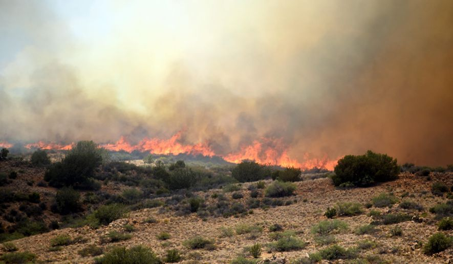 Fire burns between I-17 and Cordes Lakes on the Bug Creek Fire near Cordes Lakes, Ariz., Tuesday, June 28, 2016.  (Les Stukenberg/The Daily Courier via AP) MANDATORY CREDIT