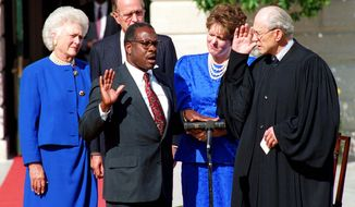Clarence Thomas, with President George H.W. Bush, first lady Barbara Bush and Justice Thomas' wife, Virginia Lamp Thomas, is sworn in as an associate justice on the Supreme Court on Oct. 18, 1991, by Justice Byron White. (Associated Press)