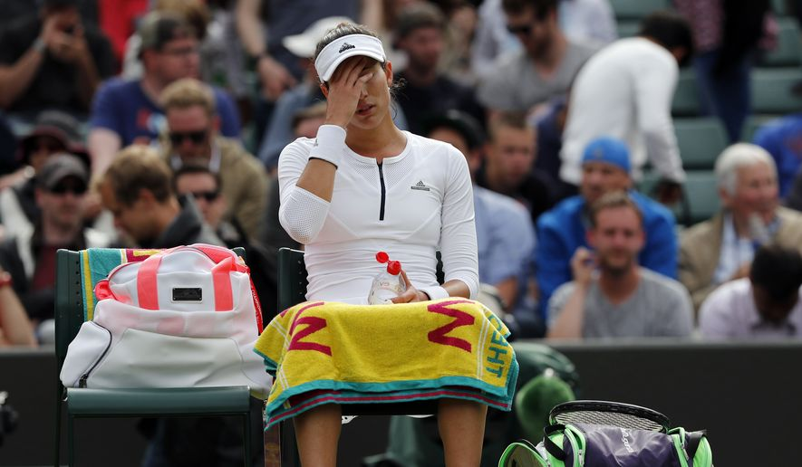 Garbine Muguruza of Spain gestures during a break in her women's singles match against Jana Cepelova of Slovakia on day four of the Wimbledon Tennis Championships in London, Thursday, June 30, 2016. (AP Photo/Ben Curtis)