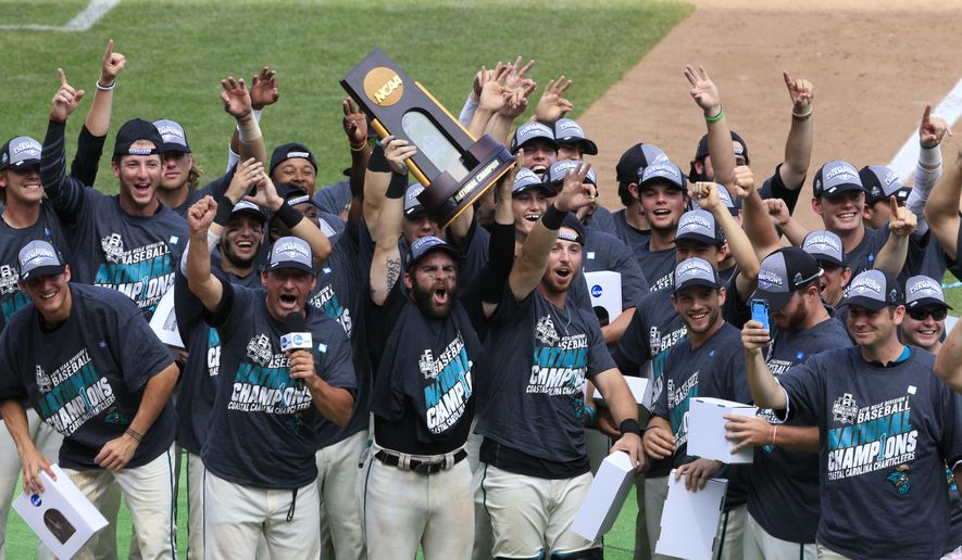 Coastal Carolina players celebrate their 4-3 victory over Arizona to win the championship after Game 3 of the NCAA College World Series baseball finals in Omaha, Neb., Thursday, June 30, 2016. (AP Photo/Nati Harnik)