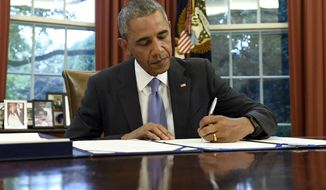 President Barack Obama signs the FOIA Improvement Act of 2016 in the Oval Office of the White House in Washington, Thursday, June 30, 2016. Obama also signed the Puerto Rico Oversight, Management, and Economic Stability Act. (AP Photo/Susan Walsh)