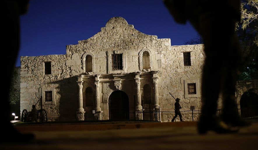 "FILE - In this March 6, 2013 file photo, Dan Phillips, a member of the San Antonio Living History Association, patrols the Alamo during a pre-dawn memorial ceremony to remember the 1836 Battle of the Alamo and those who fell on both sides, in San Antonio. The lead expert in the development of a long-term master plan for the Alamo says a first-rate overhaul will require years of study and fundraising. The San Antonio Express-News reports that George Skarmeas of Preservation Design Partnership of Philadelphia says a careful examination of the area, through documentation and archaeological work, will guide the project. He says construction could start in 2021 with a ""soft opening"" possible in 2024. (AP Photo/Eric Gay, File)"