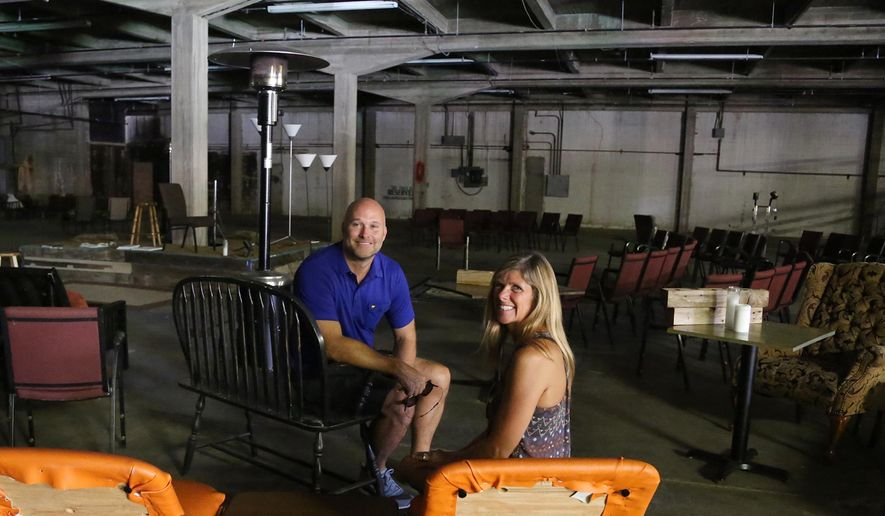 ADVANCE FOR MONDAY JULY 4 AND THEREAFTER - Acts Church pastors David and Kim Booker sit in a old county fallout shelter located next to their sanctuary, Thursday, June, 23, 2016, in Waco, Texas. The congregation is seeking to raise $1.7 million to transform the 17,000-square-foot warehouse next door to the church which is located downtown. The church bought the warehouse eight years ago when it moved from Steinbeck Bend Drive, before the downtown area began to boom with redevelopment. (Rod Aydelotte/Waco Tribune Herald, via AP)