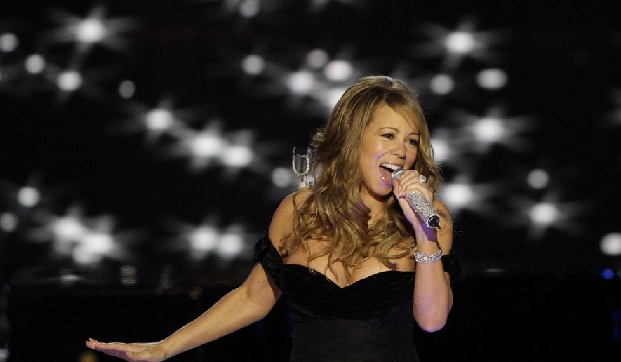 FILE - In this Jan. 20, 2009, file photo, Mariah Carey performs at the Neighborhood Inaugural Ball in Washington. Music is at the heart of the annual Essence Festival in New Orleans, and this year is no different. Fans will get to hear from first-timers Mariah Carey, Puff Daddy and Jeremih as well as from festival veterans Charlie Wilson, Maxwell, New Edition, Tyrese and Lalah Hathaway - all of whom are scheduled to perform inside the Superdome Friday, July 1, 2016, through Sunday. (AP Photo/Alex Brandon, File)