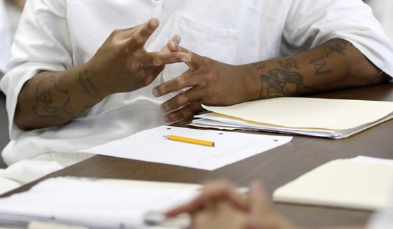 In this June 25, 2016 photo, an inmate talks aloud during a skills class geared for inmates getting ready to be released from prison at the Holliday unit in Huntsville, Texas.  It is officially swelter season in Texas, and for most of the 150,000 inmates in the state's sprawling prison system, it means another summer of seemingly endless months in cells where temperatures can climb north of 100 degrees. How many more summers prisoners live without air conditioning will depend on how and when the courts rule in a years-long fight between prisoner advocates and Texas corrections officials. (Rose Baca /The Dallas Morning News via AP)