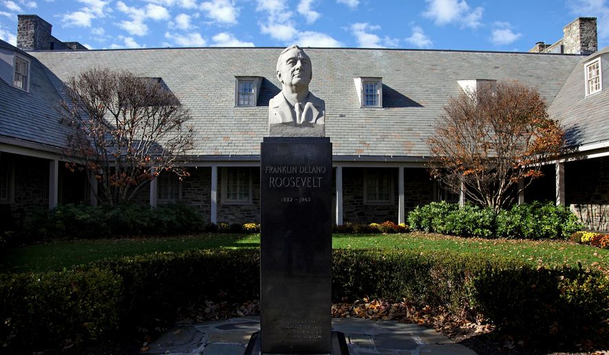 "FILE - This Monday, Nov. 2, 2009, file photo shows the bust of President Franklin D. Roosevelt in front of the Franklin D. Roosevelt Presidential Library and Museum in Hyde Park, N.Y. The library and museum is marking its 75th anniversary, being celebrated Thursday, June 30, 2016, with a ceremony for library members and invited guests only, followed by the public opening of the library exhibit ""Day of Infamy: 24 Hours that Changed History."" (AP Photo/Craig Ruttle, File)"