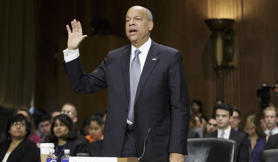 Homeland Security Secretary Jeh Johnson is sworn in on Capitol Hill in Washington, Thursday, June 30, 2016, prior to testifying before the Senate Judiciary Committee for an oversight hearing on his cabinet agency. (AP Photo/J. Scott Applewhite)