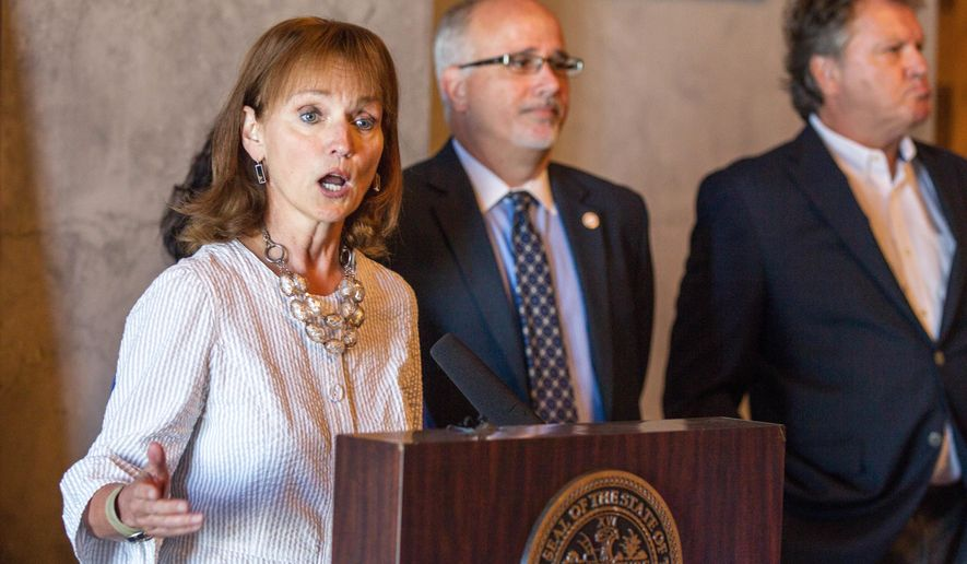 House Speaker Beth Harwell, R-Nashville, speaks during a news conference at the state Capitol in Nashville, Tenn., on Thursday, June 30, 2016, about a health coverage task force's proposals for Medicaid expansion in Tennessee. From right behind her are Republican Reps. Steve McManus of Memphis and Roger Kane of Knoxville. (AP Photo/Erik Schelzig)