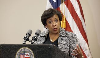 U.S. Attorney General Loretta Lynch takes questions from the media, after attending a Los Angeles Police Department technology briefing as part of her national community policing tour in Los Angeles Wednesday, June 29, 2016. Lynch was in Los Angeles for the last stop in a six-city community policing tour highlighting departments she sees as role models for law enforcement. Lynch says one of the issues law enforcement is struggling with is transparency, saying it's important departments are as open as possible without compromising investigations. (AP Photo/Nick Ut)