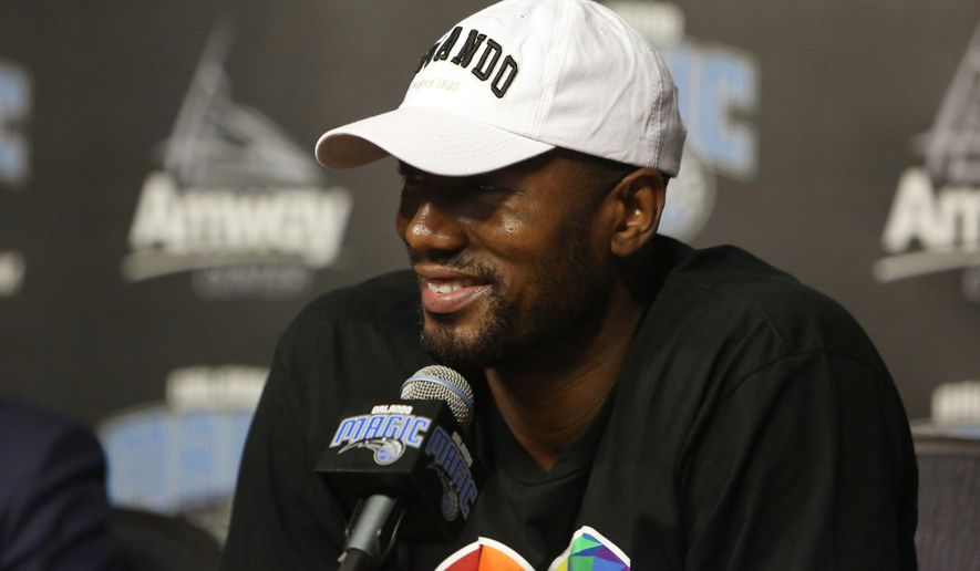 The Orlando Magic's Serge Ibaka speaks during a news conference Thursday, June 30, 2016, in Orlando, Fla. The Magic landed the veteran Ibaka in a trade with Oklahoma City that sent Victor Oladipo, Ersan Ilaysova and the rights to Domantas Sabonis, who was taken 11th overall in the draft. (Charles King/Orlando Sentinel via AP)