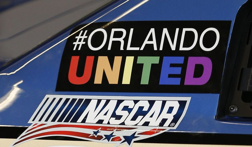 "A ""#Orlando United"" sticker is displayed on the car of Dale Earnhardt Jr. at NASCAR Sprint Cup auto racing practice at Daytona International Speedway, Thursday, June 30, 2016, in Daytona Beach, Fla. (AP Photo/Wilfredo Lee)"