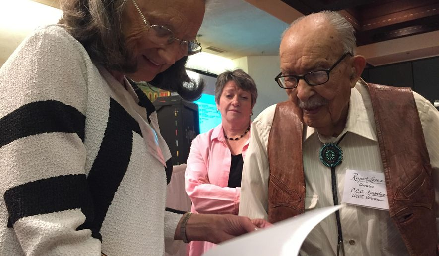 In this Friday, June 24, 2016 photo, former Civilian Conservation Corps laborer Rupert Lopez, 100, right, of Corrales, N.M., speaks with Nina Roosevelt Gibson, a granddaughter of President Franklin D. Roosevelt in Santa Fe, N.M on , in Santa Fe, N.M. The two met at a symposium about the legacy of the New Deal organized by the New Mexico chapter of the National New Deal Preservation Association. (AP Photo/Morgan Lee)