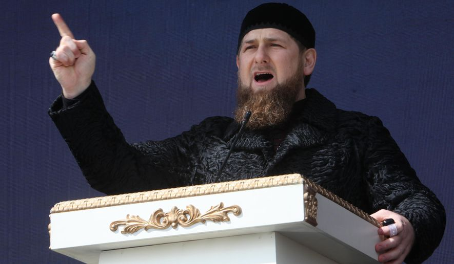 """FILE - In this Wednesday March 23, 2016 file photo, Chechen regional leader Ramzan Kadyrov addresses a rally marking the 13th anniversary of the adoption of the Constitution of Russian region of Chechnya, in the regional capital of Grozny, Russia. Russian state television on Thursday is to broadcast the opening episode of """"Live - The Team,"""" in which participants compete to become an assistant to leader of Chechnya Ramzan Kadyrov. (AP Photo/Musa Sadulayev, File)"""